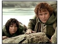 The Lord of the Rings: The Two Towers movie still: Frodo (Elijah Wood) and Sam (Sean Astin) cautiously approach the black gates of Mordor in The Lord of the Rings: The Two Towers