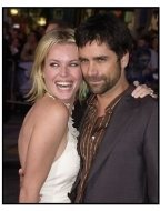 "Rebecca Romijn-Stamos and John Stamos at the ""X2: X-Men United"" premiere"