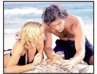 Swept Away movie still: Amber (Madonna) gets stranded on an island with Giuseppe (Adriano Gianinni) in Swept Away