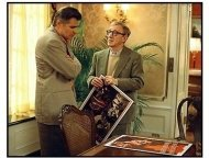 Hollywood Ending movie still: Studio head Hal Yeager (Treat Williams) shows Director Val Waxman (Woody Allen) some poster ideas for his new film