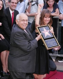Johnny Grant and Hilary Swank
