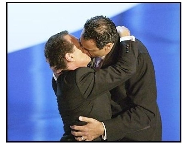 Garry Shandling kisses Emmy Nominee Brad Garrett at The 55th Annual Primetime Emmy Awards
